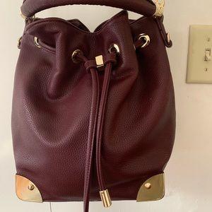 Burgundy faux leather crossbody bag